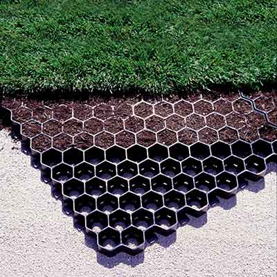 Grass Pavers provide structural support to grassy roads, driveways and parking lots.